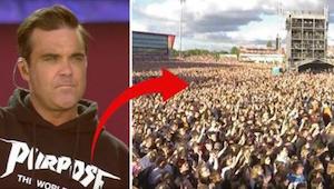 Robbie Williams zingt ''Angels'' voor de slachtoffers van terrorisme in Manchest